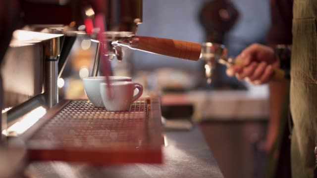 barista making coffee using a coffee maker - canteen stock videos & royalty-free footage