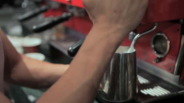 barista making coffee with heart shape in froth - conceptual symbol stock videos and b-roll footage