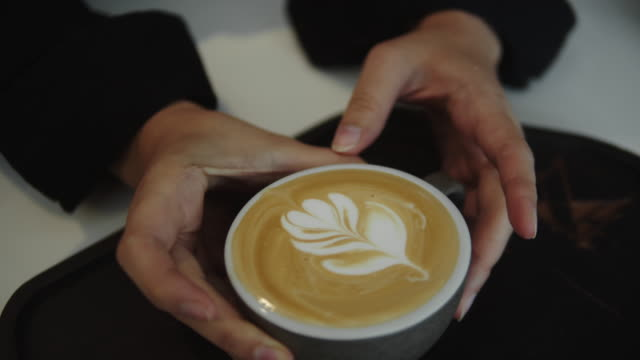 barista pouring coffee in cafe. - serving food and drinks stock videos & royalty-free footage