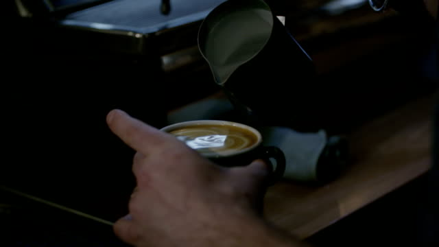 barista pouring milk into coffee - froth art stock videos and b-roll footage