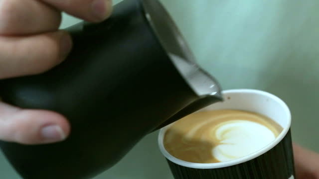 barista pours milk into coffee. - espresso stock videos & royalty-free footage