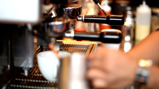 HD: Barista prepare milk foam using latte steamer