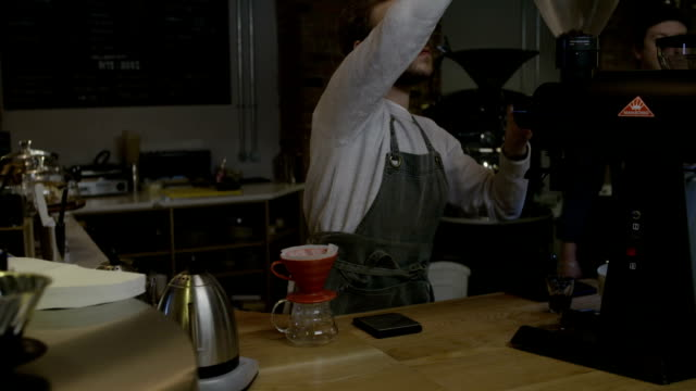 barista preparing coffee - vanguardians stock videos & royalty-free footage