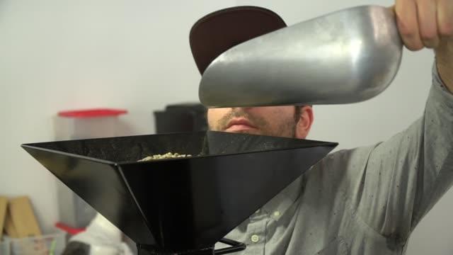 Barista Roasting Raw Coffee Beans-Slow Motion