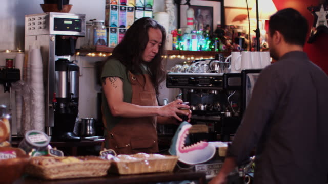 barista serving coffee in reusable cup - coffee cup stock videos & royalty-free footage