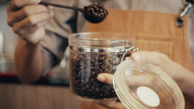 barista smelling coffee beans. - roasted coffee bean stock videos & royalty-free footage