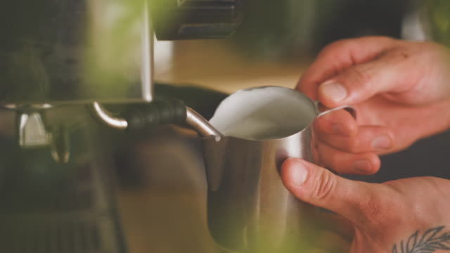 barista steaming milk by the espresso maker - dairy product stock videos & royalty-free footage