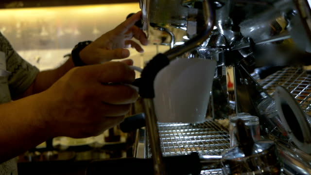barista steaming milk for hot cappuccino - espresso maker stock videos and b-roll footage