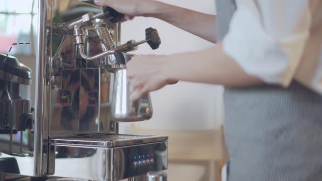 barista steaming milk, slow motion, medium shot - foam material stock videos & royalty-free footage