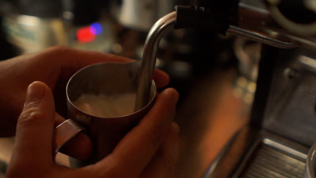barista steaming milk to prepare cappuccino - coffee drink stock videos & royalty-free footage