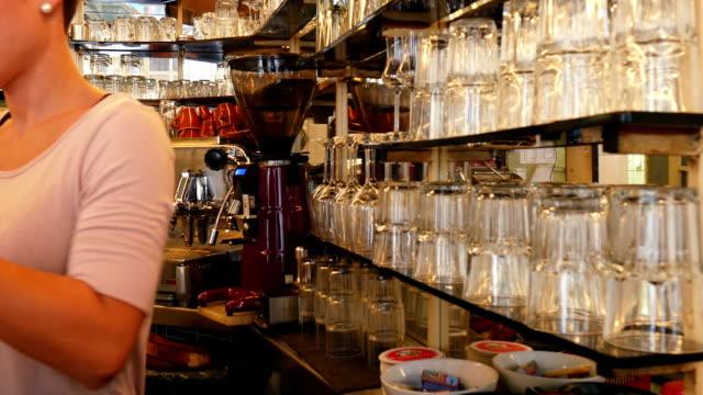 Barista Working In Coffee Shop (4K/UHD to HD)