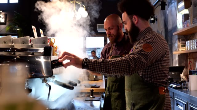 baristas at a coffee shop having problems with a espresso maker - mistake stock videos & royalty-free footage