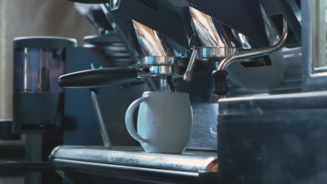 slo mo; barista's making coffee at counter bar. - breakfast room stock videos & royalty-free footage