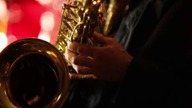 baritone saxophone closeup - saxophone stock videos and b-roll footage