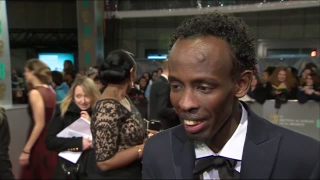 barkhad abdi describes working with tom hanks during red carpet interview at the baftas 2014 - 2014 stock videos & royalty-free footage