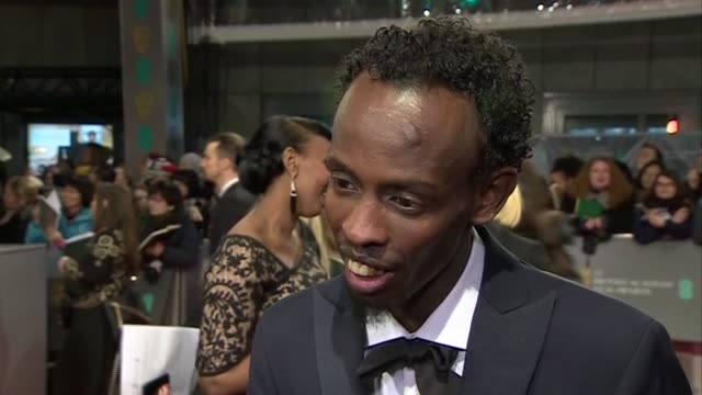 barkhad abdi speaks about his experiences filming captain phillips during red carpet interview at the baftas 2014 - 2014 stock videos & royalty-free footage