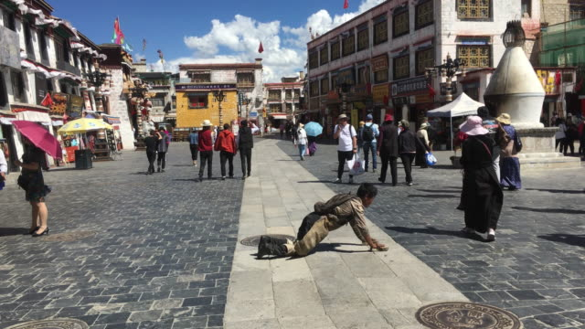 barkhor street , a historical residential and business district around the jokhang temple, is also the traditional worship route for pilgrims of... - pilgrim stock videos & royalty-free footage