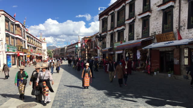 barkhor street a historical residential and business district around the jokhang temple is also the traditional worship route for pilgrims of tibetan... - pellegrino video stock e b–roll