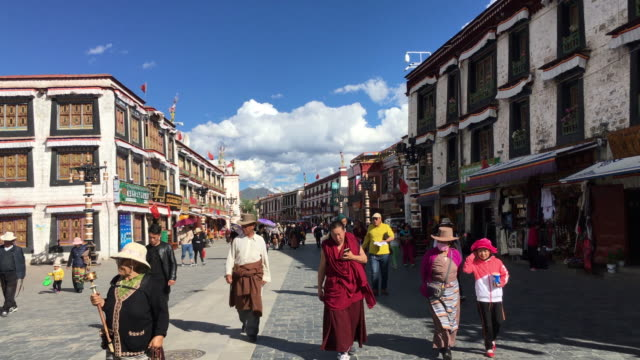 barkhor street a historical residential and business district around the jokhang temple is also the traditional worship route for pilgrims of tibetan... - traditionally tibetan stock videos & royalty-free footage