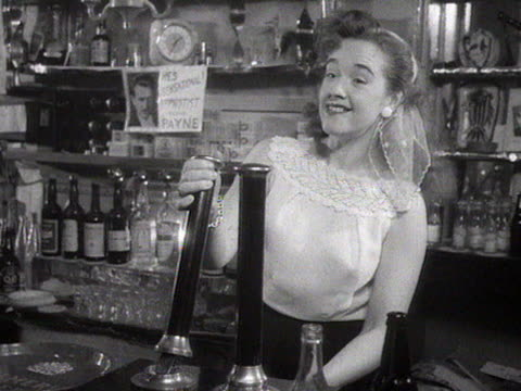 barmaid pulls a pint of beer for a customer in a pub. - alcohol drink stock videos & royalty-free footage