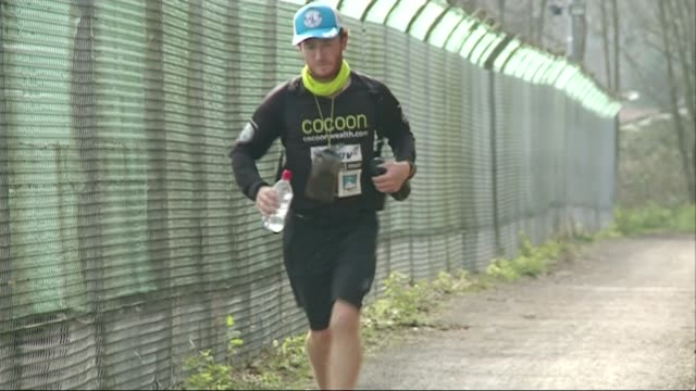 barman kevin carr completes record breaking roundthe worldrun england devon kevin carr interview sot kevin carr running alon gpast wire fence kevin... - record breaking stock videos & royalty-free footage