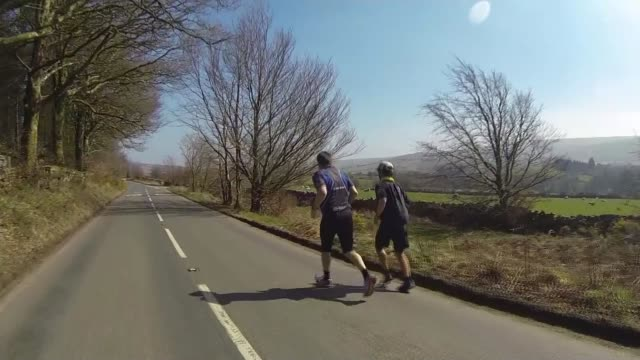 barman kevin carr completes record breaking roundthe worldrun kevin carr running along dartmoor road with fellow runner kevin carr hugged and kissed... - record breaking stock videos & royalty-free footage