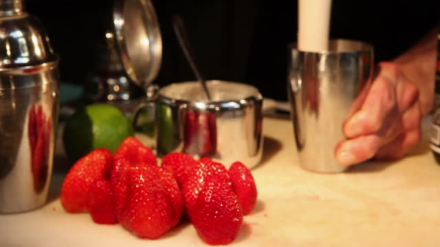 ms r/f barman preparing strawberry and sake caipirinha, typical brazilian drink / sao paulo, brazil - cachaça stock videos & royalty-free footage