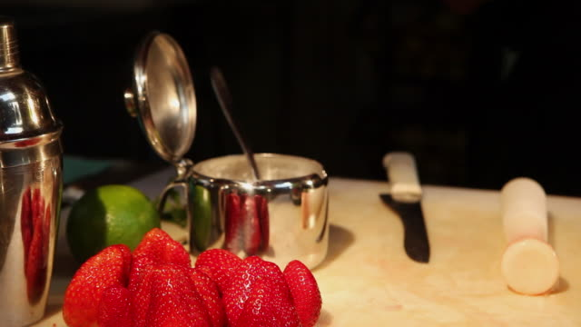 ms barman preparing strawberry and sake caipirinha, typical brazilian drink / sao paulo, brazil - cachaça stock videos & royalty-free footage