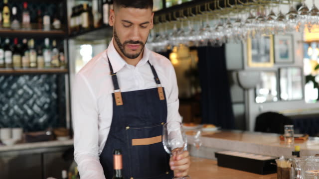 barman serving wine in bar - part time worker stock videos & royalty-free footage