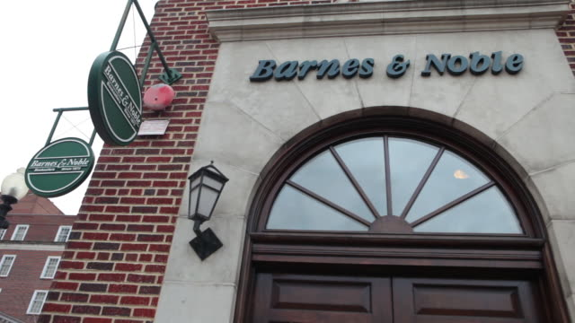 ms barnes noble brick storefront woman entering store cu exterior signage ms corner of store various signs and entrance various cu of signage ms... - barnes & noble stock videos and b-roll footage
