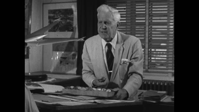 barnes wallis explains how he tested various weighted spheres by firing the into a test tank to see how they could skip over the water; 1967. - medium shot stock videos & royalty-free footage