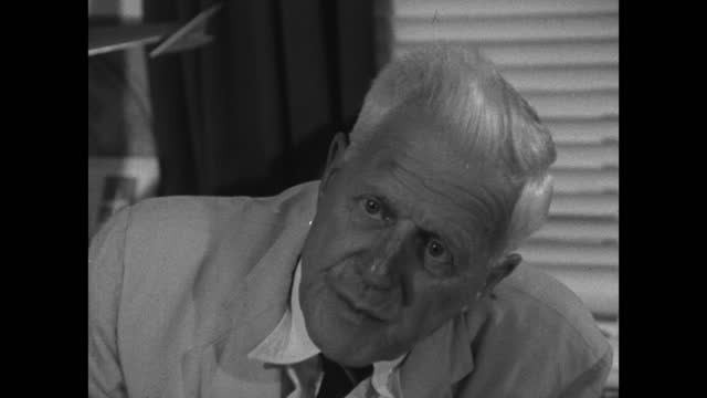 barnes wallis, speaking in 1967, believes flying in smaller, lighter aircraft, carrying less people will cost less and be more fuel efficient; 1967. - medium shot stock videos & royalty-free footage