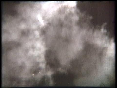 a barnstorming airplane, trailing a smoke marker, spirals into a dive. - acrobatica aerea video stock e b–roll