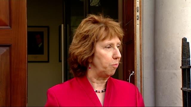 baroness catherine ashton press statement alternative angle; england: london: ext low angle shots eu flag and union jack flag on building flag masts... - 男爵夫人点の映像素材/bロール