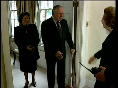 baroness thatcher shakes hands with general augusto pinochet as he awaits decision on his extradition to spain to face charges of murder and human... - baroness stock videos & royalty-free footage
