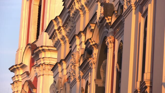 ms of baroque collegiate church in the evening sun - baroque stock videos & royalty-free footage