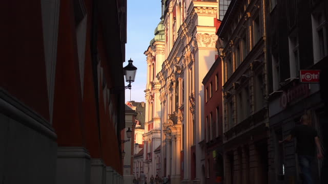 baroque collegiate church in the evening with pedestrian wallking along - baroque stock videos & royalty-free footage