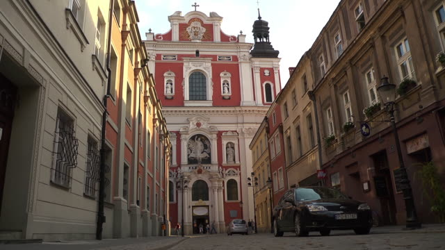 baroque collegiate church with sun - baroque stock videos & royalty-free footage