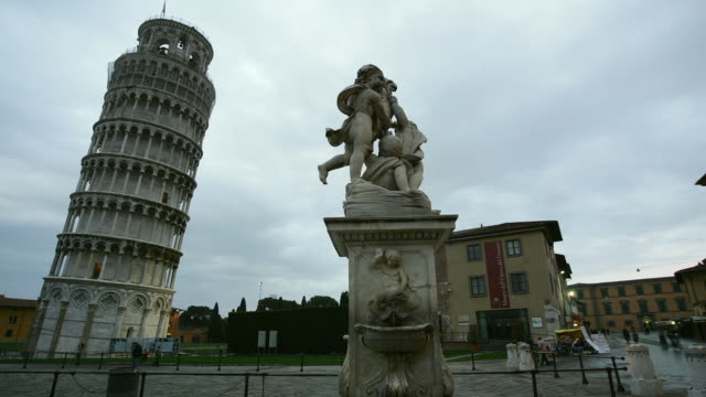 T/L WS Baroque fountain and Leaning Tower, day to night, Piazza del Duomo, Pisa, Tuscany, Italy