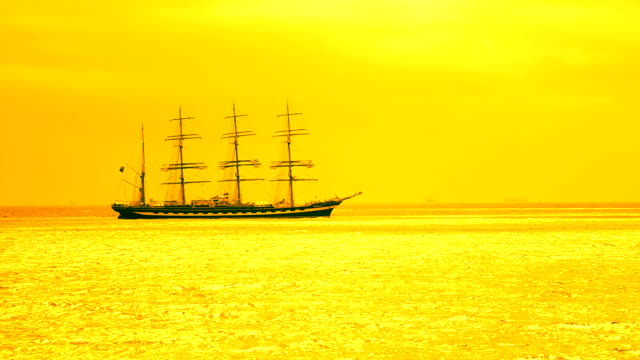 barque at sunset silhouette