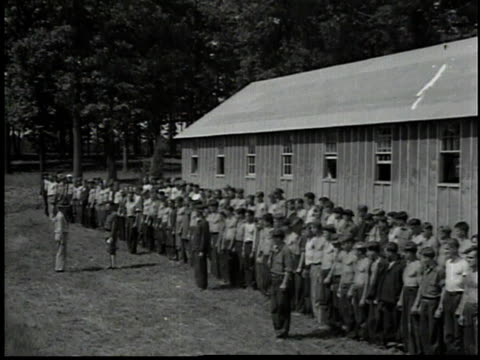 barracks of ccc, bugleboy blowing morning call / men brushing teeth in barracks / man shaving / men making up their cots / man smoothing sheets on a... - 1934 stock videos & royalty-free footage