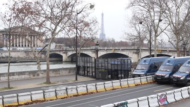 barrages of police and gendarmes to prevent access to the Place de la Concorde view of the National Assembly and the Eiffel Tower in the background...