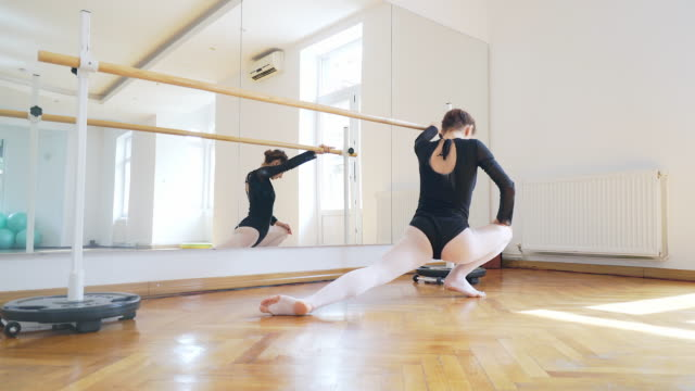 barre ballet warm up. - barre stock videos and b-roll footage