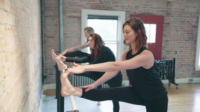 barre stretching exercises - barre stock videos & royalty-free footage
