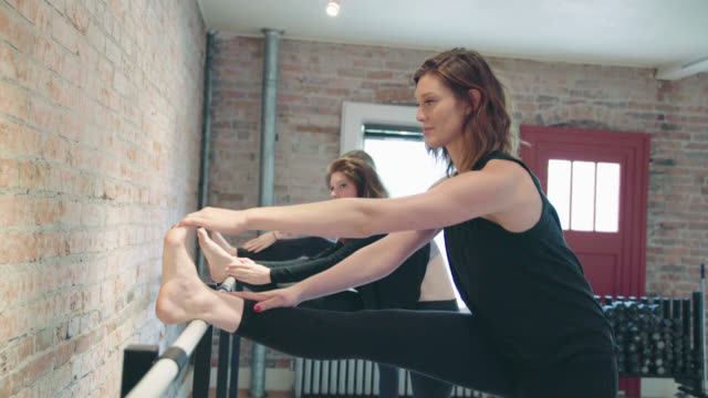 barre stretching exercises - barre stock videos and b-roll footage