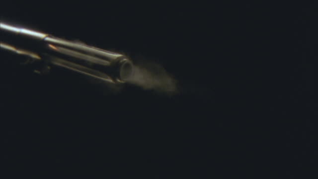 vídeos de stock e filmes b-roll de slo mo, cu, barrel of rifle firing bullet - criminoso
