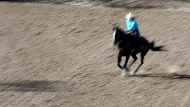 barrel racing outdoor rodeo arena - rodeo stock videos & royalty-free footage