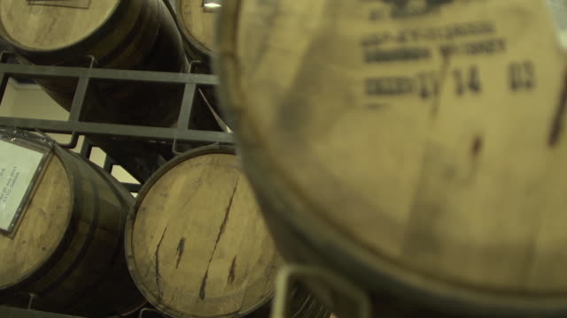 Barrels of bourbon whisky stacked in rows
