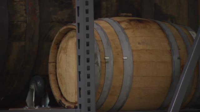 barrels of craft liquor at copper fiddle distillery and north shore distillery on june 30, 2014 near chicago. - absinth stock-videos und b-roll-filmmaterial