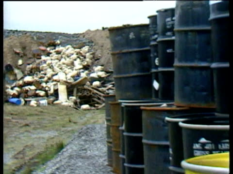 Barrels of nuclear radioactive waste on open landfill site Radioactive nuclear waste at landfill site on November 01 1994